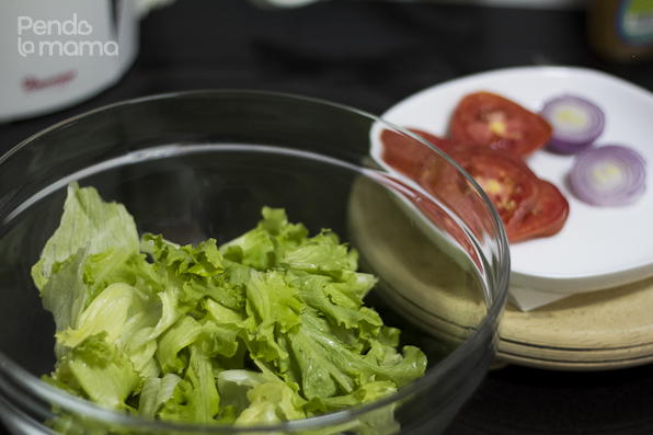 while the meat is cooking prep the other salad ingredients. Wash greens, chop tomatoes and onions