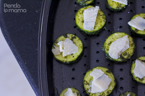 brush an oven pan/sheet with oil, arrange the coated discs and top each with a piece or parmesan