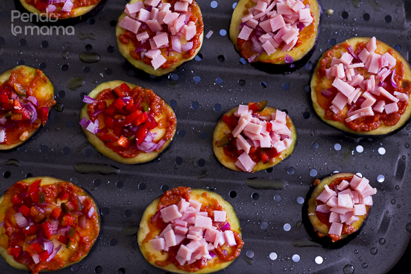 arrange the eggplant discs on a baking pan/sheet and smear the tomato paste on each one, then add the toppings