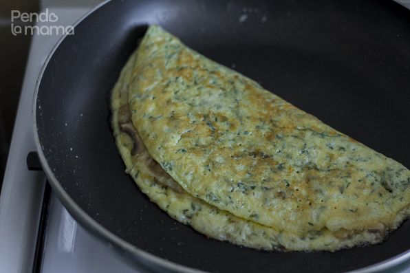 fold the omelet in half and continue cooking on low heat till the inside is done. You will turn it a a couple f times.