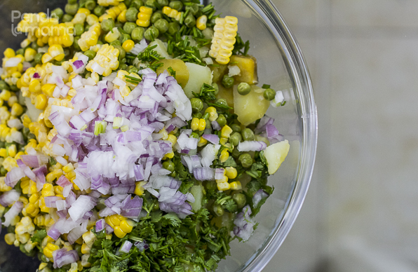 add the peas, sweetcorn, onions, dhania and