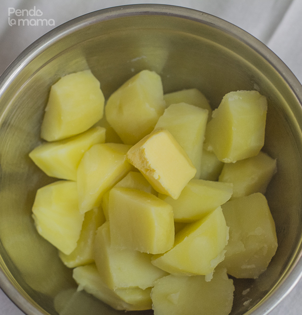 add a chunky piece of butter and mix with a spoon while the potatoes are still hot so that the butter melts and coats the potatoes