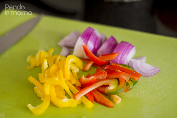 slices of onion, and red and yellow peppers