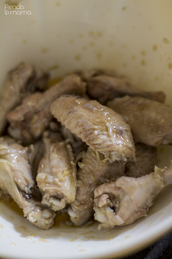 then in a separate bowl, toss the wings in the honey and lemon mix. Do just a few at a time.